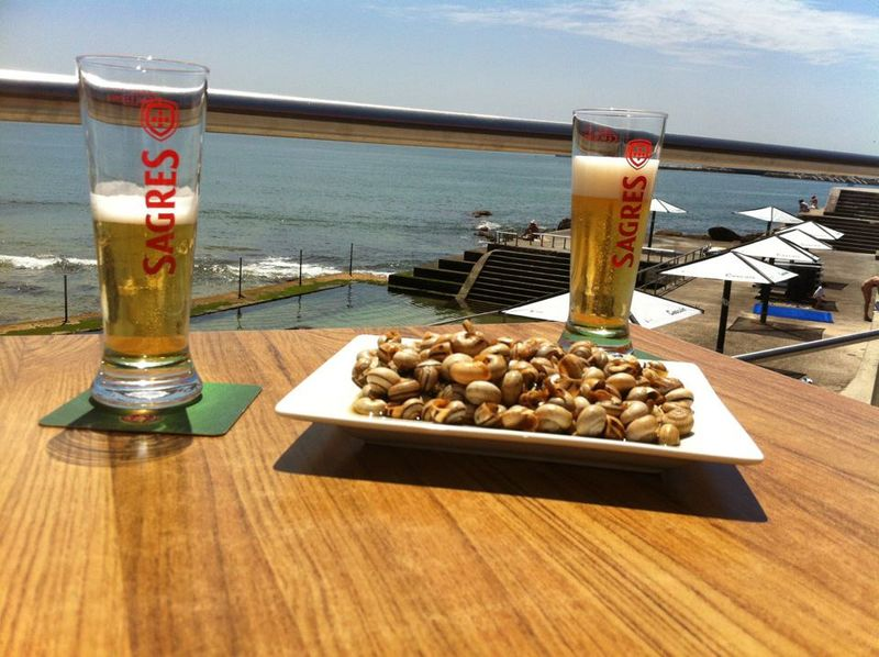In Portugal, cold beer pairs well with snails and a great view!